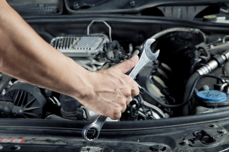 Car repair under construction